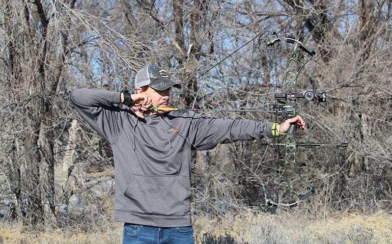 Jace Bauserman shooting Prime bow