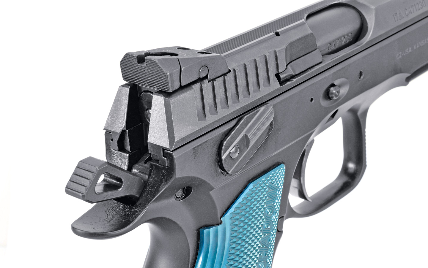 The rear sight is click- and drift-adjustable for windage, and matching flat-bottom serrations are found on the front and back of the slide.