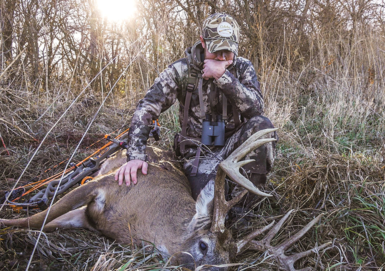 Cody Butler with Longhorn buck