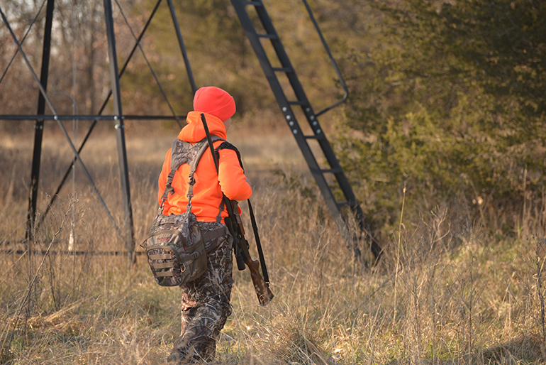 youth hunter walking to blind