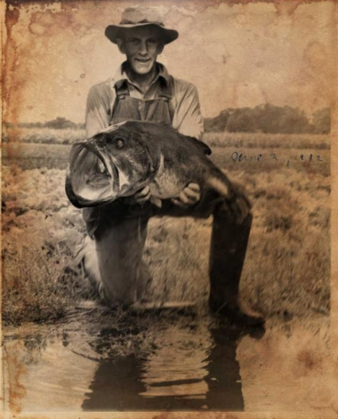George W. Perry with largemouth bass that weighed 22 pounds, 4 ounces.