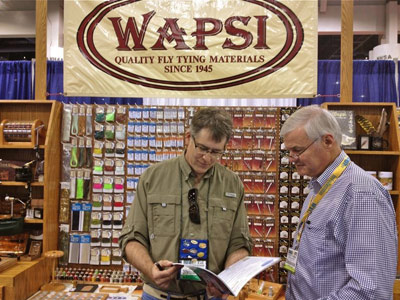 Karl Schmuecker (left), general manager of Wapsi Fly in Mountain Home, Ark., visits with Tight Lines Ltd. representative Peter Toynbee of Napier, New Zealand