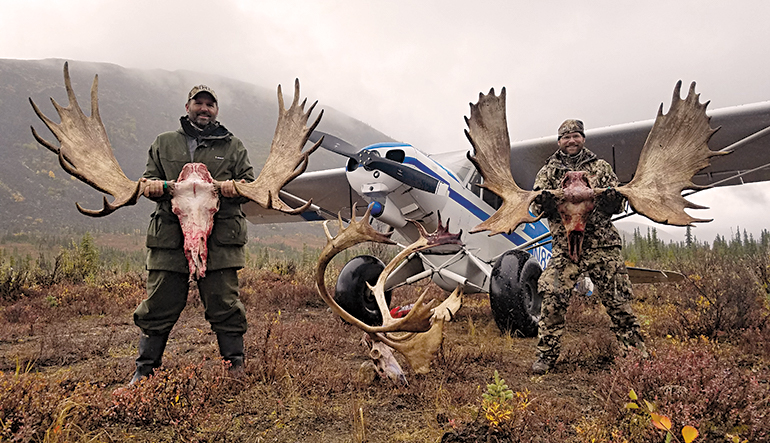 hunters with Alaskan moose