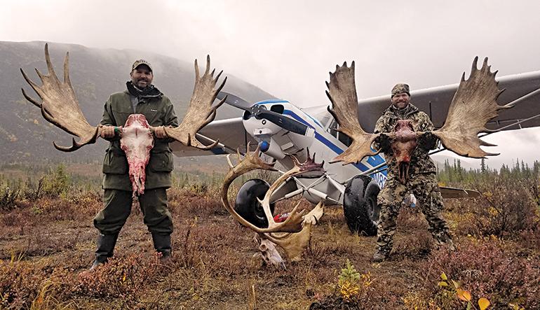 hunters with Alaskan moose