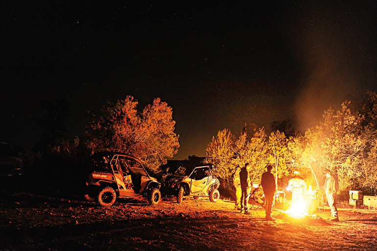 campfire in Arizona hunting camp