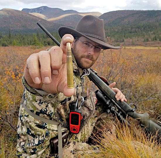armed moose hunter