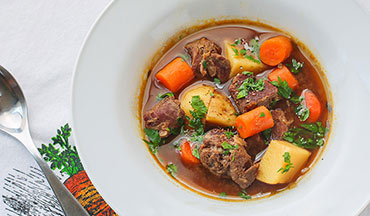 Welcome colder weather with this warming venison and stout beer stew recipe.