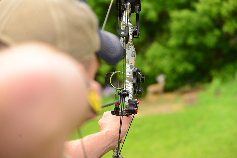 bowhunter at full draw with Burris Oracle mounted to bow for target practice