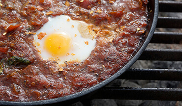It only takes 30 minutes to make this Eggs in Purgatory Recipe.