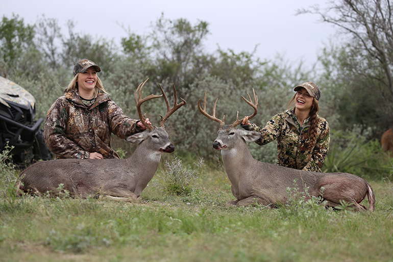 Jessica Nyberg and Emily Kantner with Texas bucks