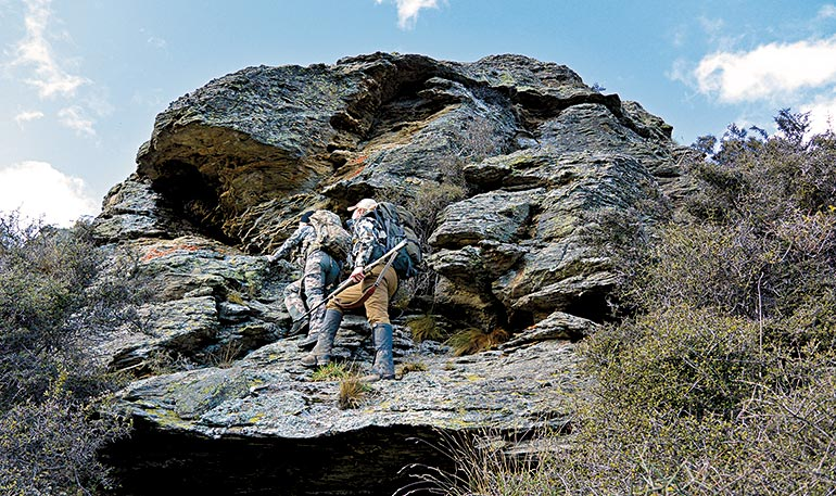 Kali Parmley and guide hiking mountain