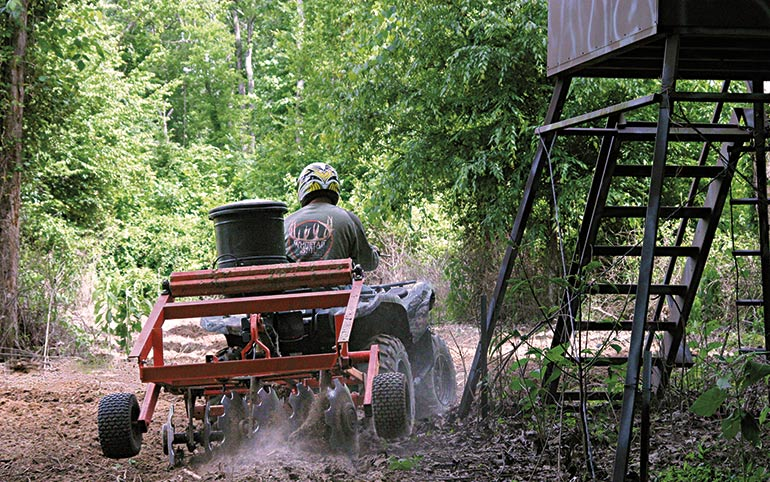 hunter planting food plot