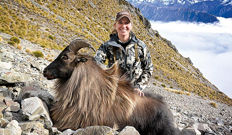 Kali Parmley with New Zealand tahr