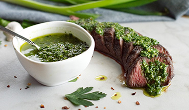 Bright, garlicky chimichurri pairs perfectly with cooked and seared venison tenderloin. This sous vide recipe couldn't be easier and results in an impressive dish with an explosion of flavors in every bite!