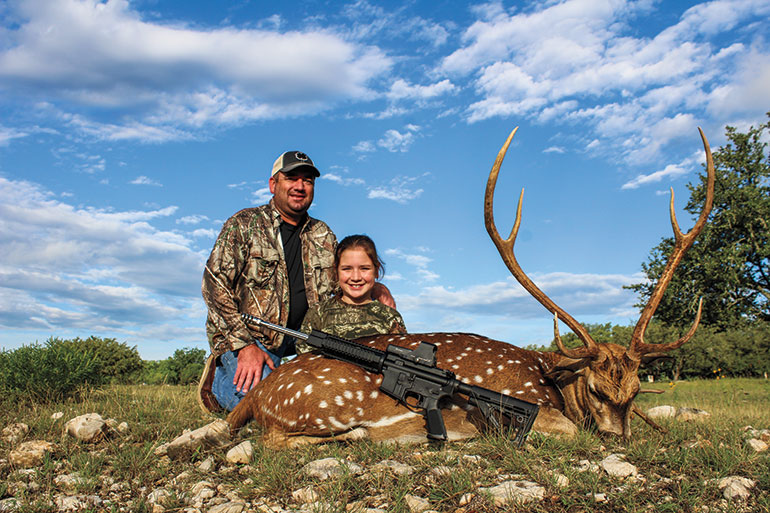 Natalee Stephenson with axis buck