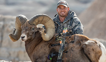 A new hunter-harvested world-record bighorn was arrowed by Clayton Miller in South Dakota.