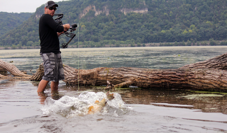MegaMouth-Reel-shooting-fish-near-log.jpg
