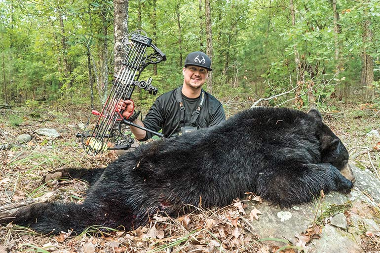 Brandon Adams with bear