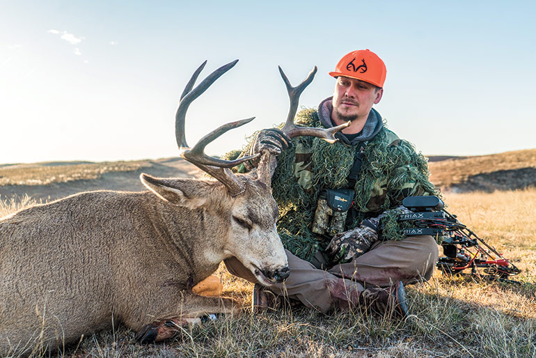 Brandon Adams with mule deer