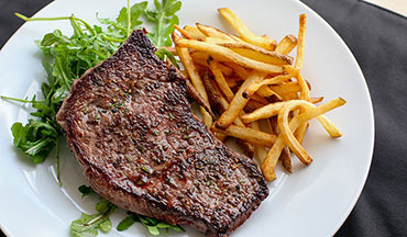 A simple, classic steak and French fries duo gets a wild makeover with this Elk Venison Steak-Frites Recipe.