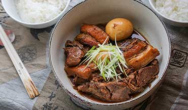 Braised pork belly is sweet, salty, and full of umami; it pairs well with venison and hardboiled eggs in this Japanese-inspired recipe.