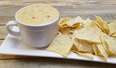 Enjoy this venison queso dip recipe right out of the slow cooker for warm, cheesy goodness in every bite.
