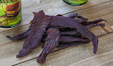 This venison jerky recipe gets its sweet and spicy flavors from pineapple juice and jalapeño powder.