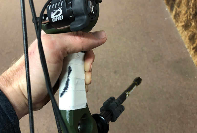 proper hand placement markings on bow grip