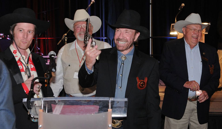 Cimarron Firearms and Pietta Firearms present Chuck Norris with Special Frontier Revolver at Former Texas Rangers Foundation Gala.