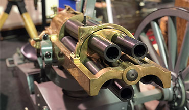 "Firearms News Senior Field Editor David Fortier chats with SARCO's founder, Charles ""Cholly"" Steen, and General Manager, Butch Steen, about the Hotchkiss 37mm Revolving Cannon on display at their Easton, PA gun shop."