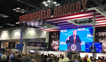 An arrest was made following a cell phone being thrown on stage as President Trump prepared to address the NRA Annual Meetings and Lt. Col. Oliver North was ousted as the NRA President.
