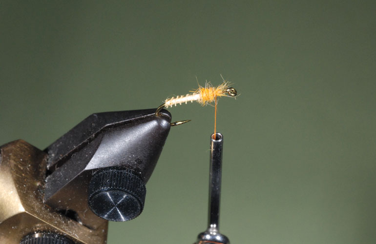 //content.osgnetworks.tv/flyfisherman/content/photos/How-to-Tie-the-Puff-Diddy-Fly-Step-2.jpg