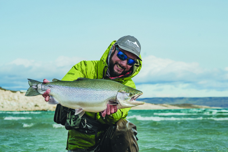 Big, hungry rainbow trout await in the clear waters of Lago Strobel.