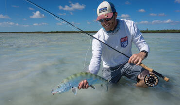 Author Kyle Sea sets his sights on using surface flies for bonefish on the flats of Andros.