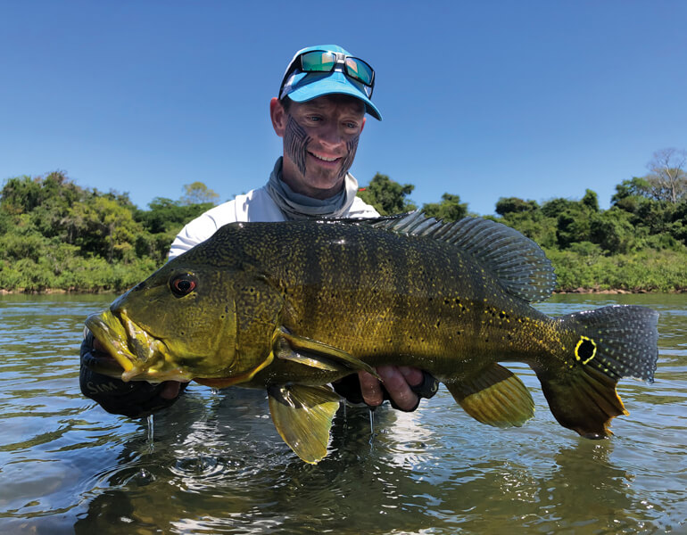 //content.osgnetworks.tv/flyfisherman/content/photos/Untamed-Angling-Ross-Peacock-Bass.jpg