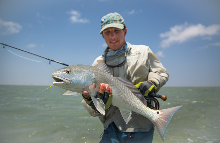 //content.osgnetworks.tv/flyfisherman/content/photos/Wading-for-Texas-Redfish-at-Laguna-Madre.jpg