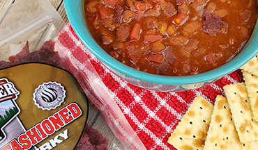 Looking for a low maintenance, hearty recipe for out in the bush? This Beef Jerky Chili Recipe basically has three ingredients and none of them require refrigeration.