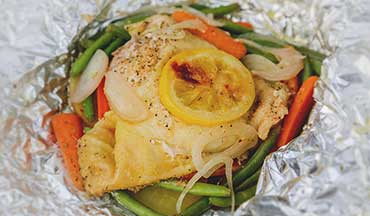 This Campfire Lemon Chicken Foil Dinner Recipe cooks directly in the aluminum foil so you can enjoy your meal without having to worry about the cleanup.