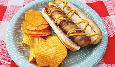 Not only will your kids love these cheesy bacon-wrapped hot dogs but you will too!