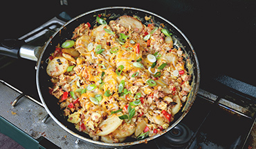 Chop up some of the ingredients in this Corned Beef and Potato Hash Breakfast Recipe at home for less prep work at camp.