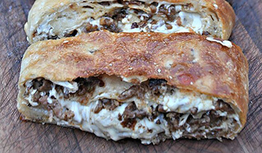 Stuffed with cheese and deliciously seasoned venison, this sausage bread recipe from
