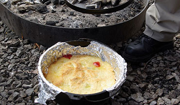 Learning how to cook with a Dutch oven is an essential skill for campfire cooking.