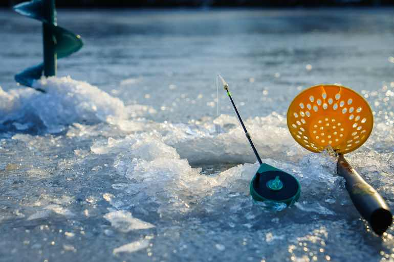 Bypass shallow weeds in favor of mid-depth flats near deep basins for ice bluegills this winter.