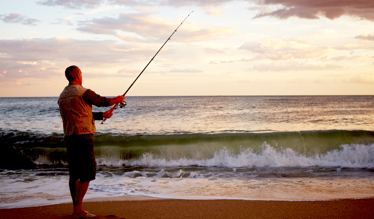 Summertime is a great time to be on the beach — catching fish.