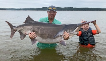 With the latest giant weighing in at 151.9 pounds, Oklahoma's Keystone Lake is ground zero for record-size paddlefish.