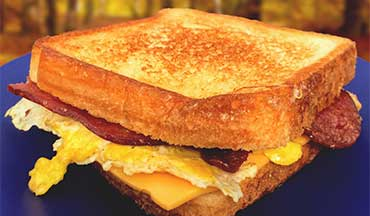 Keep your stomach full and satisfied before heading out on your adventure for the day with this easy recipe for a breakfast grilled cheese sandwich.