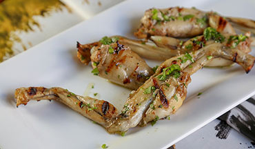 In this recipe, frog legs are marinated in a savory garam masala seasoning and grilled to perfection; summertime grilling never tasted so good!