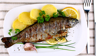 Use the freshest fish possible for this Grilled Lemon-Pepper Trout Recipe.