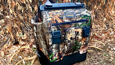The OtterBox Trooper LT 30 Cooler in the Realtree Edge camo pattern is a great way to keep your food and beverages cool while on a hunting trip.