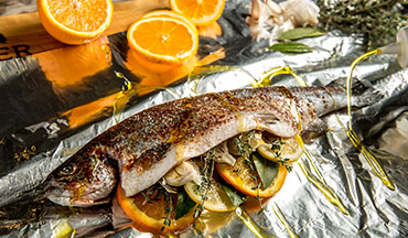This rainbow trout recipe from Traeger is a quick and delicious way to cook up your catch. Stuff your fish with orange slices and garlic-herb brown butter for flavor and then grill it in a foil packet to seal in all the goodness.